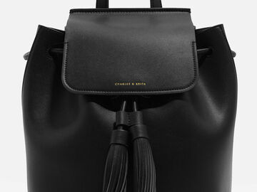 For  Sale: CHARLES AND KEITH Tasselled Backpack Black Leather