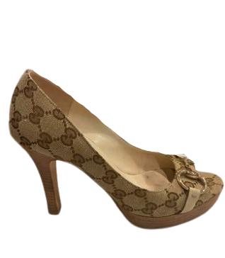 Re-sell: Canvas Beige Ebony Logo Embossed high heel Size 7